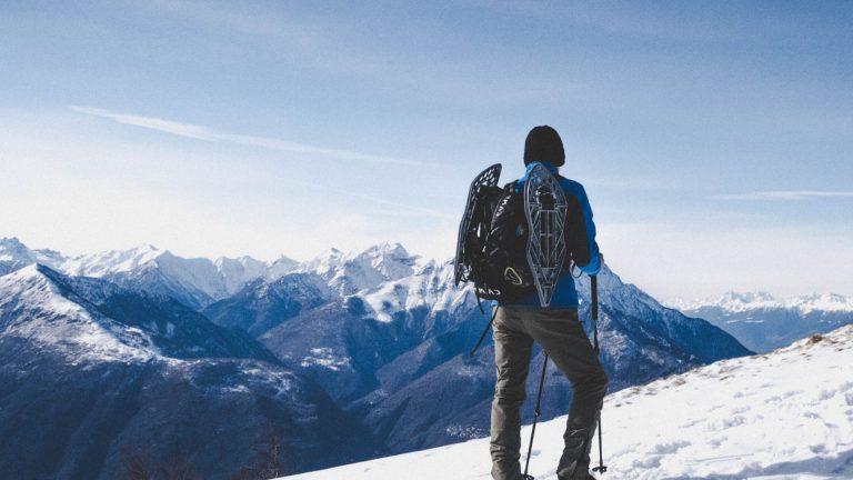 man walking the growing mountain cold